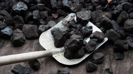 кафельный : Shovel and coal. A pile of brown coal with a shovel, lignite storage.