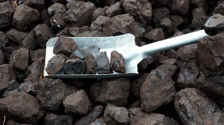 Shovel and coal. A pile of brown coal with a shovel, lignite storage.