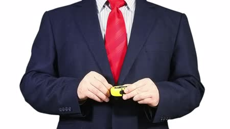 medir : Businessman using a measuring tape. Stock Footage