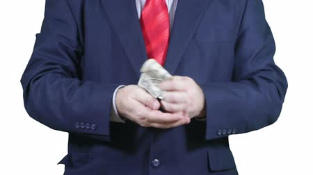 servet : Businessman counting money weighting a diamond. Stok Video