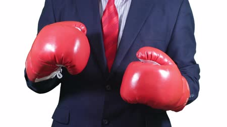 diamantes : Businessman in suit fighting in red boxing gloves. Stock Footage
