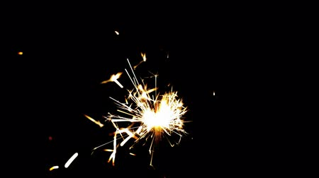 black yellow : Sparklers over black Stock Footage