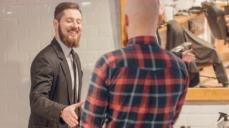 modern manhood : Pleasant cheerful barber welcoming clients