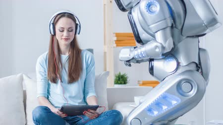 robots : Robot and positive woman resting together Stock Footage