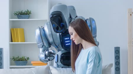 robots : Pleasant woman talking with the robot
