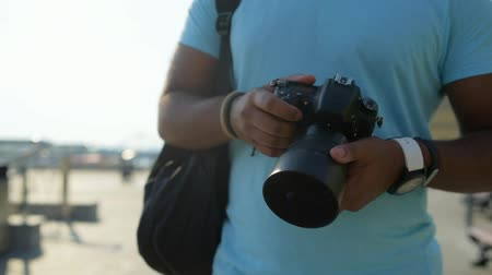 modern manhood : Close up of skillful photographer walking along the road