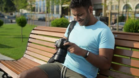 modern manhood : Positive handsome man looking at the photos