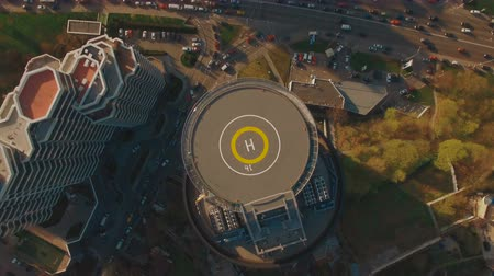 heliport : Above top view modern business center with helipad 4K UHD aerial footage