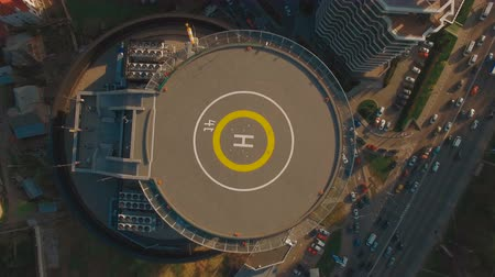 heliport : POW above top view modern business center with helipad 4K UHD aerial footage