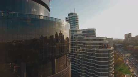 heliport : Window washer at modern business center with helipad 4K UHD aerial footage