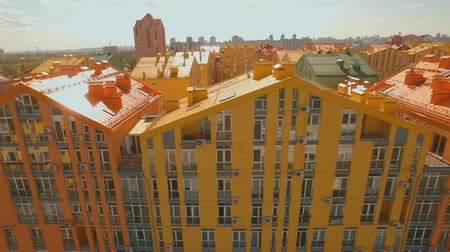 kijev : Flying over cozy comfortable colorful buildings in a European city 4K UHD aerial