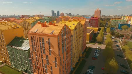 neighbor : Panorama cozy comfortable colorful buildings in a European city 4K UHD aerial