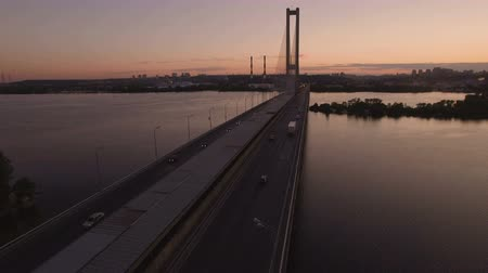bağlantılı : Bridge with trafic over the river at sunset aerial drone footage