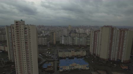 slum house : Aerial drone footage of gray dystopian urban area with identical houses