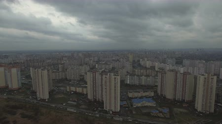 slum : Aerial drone footage of gray dystopian urban area with identical houses