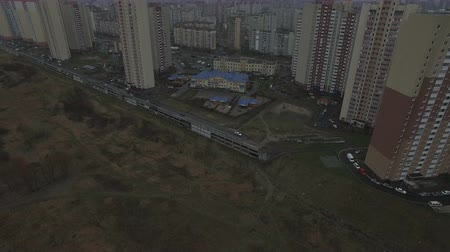 slum house : Aerial drone footage of gray urban city outskirts with identical houses