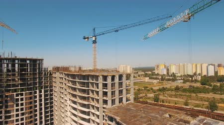 site : Aerial shot of workers in a construction, structure in the process to be build Stock Footage