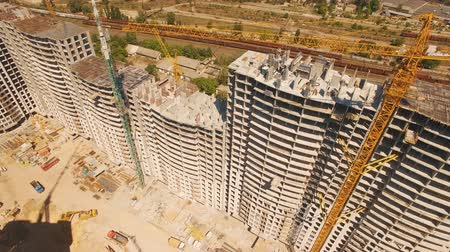 mimar : Aerial shoot of construction site with tower cranes. Drone footage