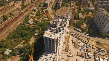 kiev : Aerial shoot of construction site with tower cranes. Drone footage