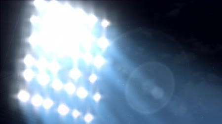 stage lights : Stadium lights flashing one by one. Dark sky in background. Stock Footage