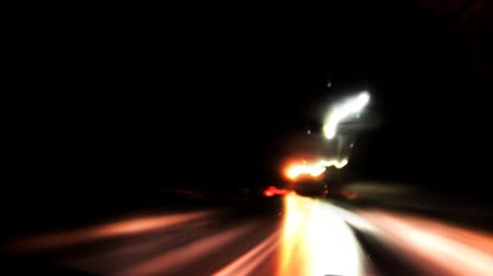 agresif : Car moving along the street. Blurred background and city lights