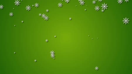 hópehely : Falling snowflakes and stars on a green background. New Years winter background.