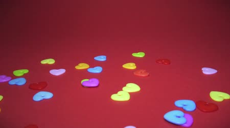 newyear : Plastic hearts on a red background