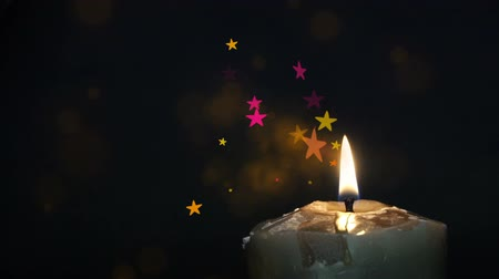 yahudi : Candle with stars, illumination from a candle, a burning candle