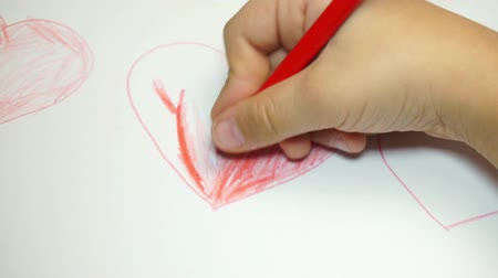 human heart : Children drawing by color pencil on little paper, determine footage for love concept. Stock Footage