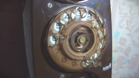 alıcı : Dialing on an old rotary style telephone. Close-up view. Stok Video