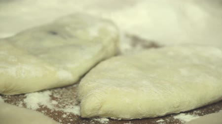 baking dishes : The chef prepares the dough for baking, raw dough on the wooden Board Stock Footage