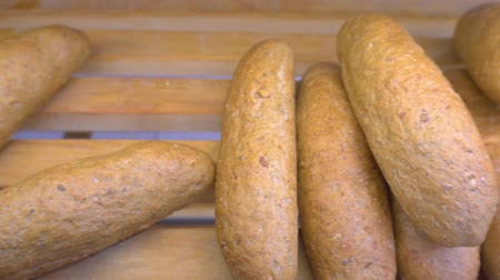 bagietka : Rye baguettes lying on the supermarket counter