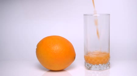 kolf : Orange Juice Pours Into Glass