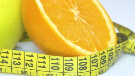 fruitarianism : fruits and measuring tape close up. The concept of diet Stock Footage