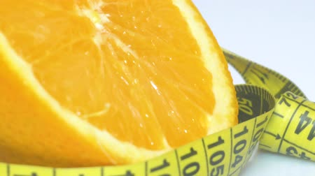груша : fruits and measuring tape close up. The concept of diet Стоковые видеозаписи