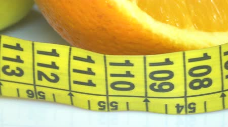 pears : Fruits and measuring tape close up. The concept of diet