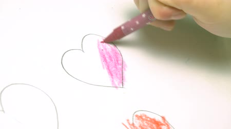 çizim : Drawing heart on white drawing paper with red color pencil. artistic concept.