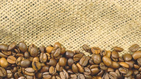 hessian : Coffee beans fall on burlap. Slow Motion. Stock Footage