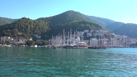 レガッタ : A large port with yachts, ships and boats against the backdrop of beautiful mountains, white houses and blue sea on a Sunny day in Turkey.