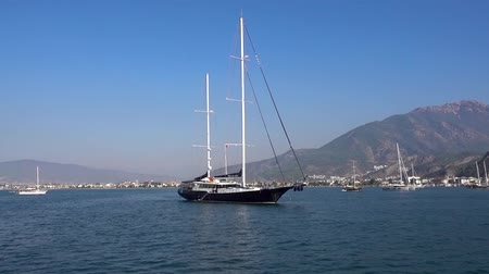fethiye : Beautiful big yacht anchored in the blue calm sea against the background of beautiful small mountains and ships on a Sunny summer day in Turkey.