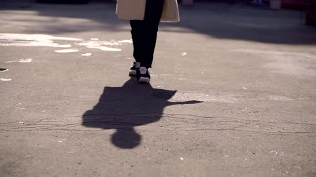 inverted : Womans shadow on a asphalt