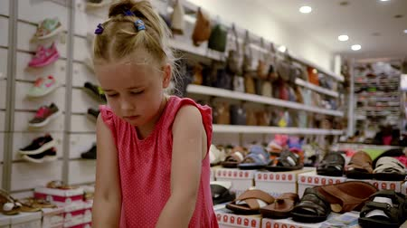 littlegirl : Cute kid with shoes on her hands. Stock Footage