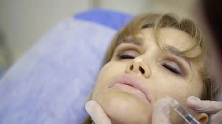 perforation : Portrait of a woman during cosmetic surgery. Stock Footage