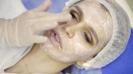 perforation : Close up shot of a womans face covered with cream.