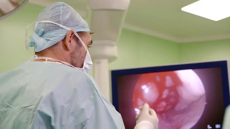electro : surgeon watching an image from endoscopic camera on a display of contemporary technological equipment
