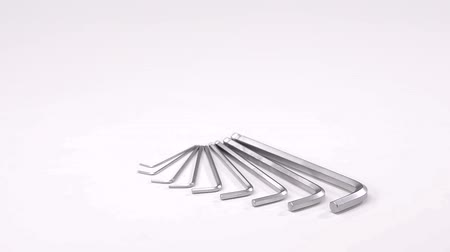 seis : complete set of hex keys different sizes is lying on a white background and rotating