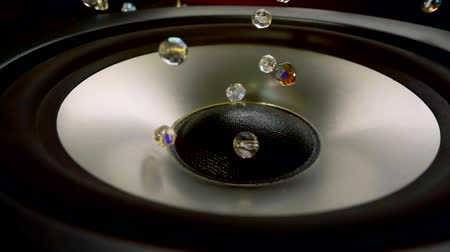 мегафон : shining beads are jumping on a working speaker surface by acoustic waves