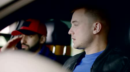 drive through : two old buddies are sitting inside a car and talking, waiting someone for driving in daytime Stock Footage