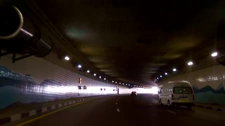 road tunnel : view of the road on which cars are traveling, now vehicles are passing through the tunnel