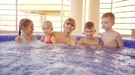 джакузи : Big happy family enjoying their time in jacuzzi together.
